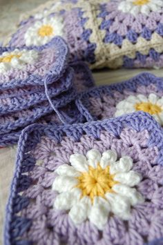 I'm almost finished with my first daisies on purple afghan for my Etsy customer, Angela. I really like how the purples make the daisy pop. T...