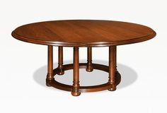 "Thomas Newman for WA HOO DESIGNS Custom Six Leg Round Table. Oak with Dark Finish. Dimensions: 68"" round, 36"" stretcher  (16"" overhang) with double thick ogee edge. Available in: Cherry, Oak, Walnut, Maple, Tiger Maple, Ash and Hand-cut Mahogany Veneers Other edge detailing available. Available in custom sizes and shapes. Available with and without leaves."
