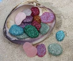 pixie dust pebbles - made from hot glue and glitter. Click to find other cute ideas! #fairy - DIY Fairy Gardens