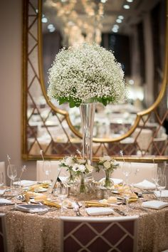 Wedding Centerpiece - Tall Baby's Breath + Small Clusters of Single Posies + Glittery Linens! See more on SMP:  http://www.StyleMePretty.com/2014/05/28/glamorous-new-years-eve-wedding-in-philly/ Photography: AsyaPhotography.com - Floral Design: PetalsLane.com