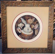 Alice in Wonderland artwork with a circular opening in the matting and framed in @larsonjuhl's Simpatico line! Custom framed by FastFrame of LoDo. #art #framing #denver #colorado #customframing #pictureframing