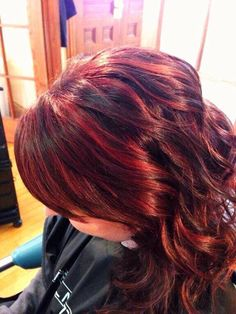 Beautiful red highlights on dark brown hair. Amy at cut and paste salon. Rochester, NH http://www.facebook.com/CutAndPasteSalon