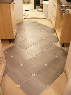diagonal- TrafficMaster Ceramica 12 in. x 12 in. Coastal Gray Resilient Vinyl Tile Flooring (30 sq. ft./case)