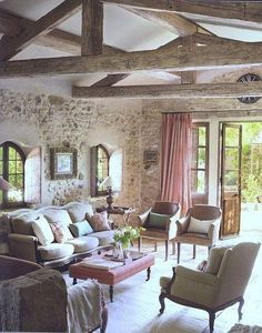 Love the exposed beams and stone walls.
