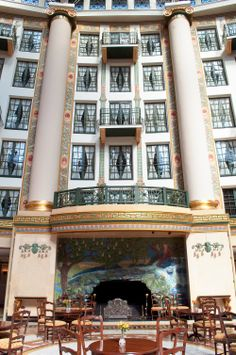 West Baden Springs Hotel at French Lick Resort. Fireplace and balconies in the atrium of this historic hotel in #Indiana #travel via #thoughtandsight