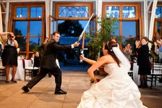 What wedding reception wouldn't be a thousand times better with a bride and groom light-saber duel?  None, methinks!