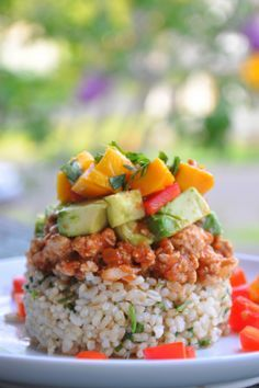 Mexican Haystacks with Ground Turkey, Avocado, Tomato, Mango, Red Bell Pepper and Cilantro on top of Brown Rice