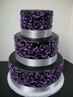 Black with Purple Scrollwork Wedding Cake. White instead of silver.