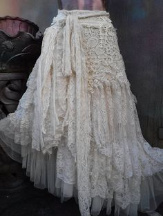 wedding skirt,tattered skirt, stevie nicks, bohemian skirt, boho skirt, gypsy skirt, lagenlook skirt,OAK, shabby wrap skirt..  she,s an absolutely gorgeous bohemian wrap around shabby skirt in ivory,beige and off white hues kissed with bridal beaded laces,brocade lace,other assorted bridal laces,beaded bridal decals,netting,rose trims,crochet,bridal fringing and shabby detail with roses where she ties giving her a shabby chic feel.....these pieces are works of art and sell way below their…