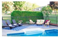 I LOVE this patio arrangement with 2 outdoor rugs for one defined sitting space and one defined tanning space!! DO THIS