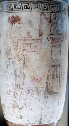 Woman holding a plemochoe and visiting a grave. White-ground Attic lekythos, ca…
