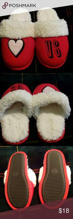 Victoria's Secret Slippers. NWOT. Size Small. Never worn slippers by V. S. Red and white with pink heart and black outline, and VS in black. Super soft, cozy, warm and comfy. I ended up with 2 pairs just alike, so selling one. No tags, but you can tell that they're brand new. Victoria's Secret Intimates & Sleepwear