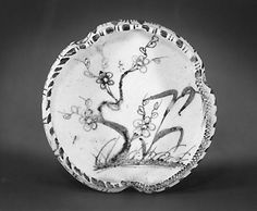 Dish  Period: late Momoyama (1573–1615) or early Edo (1615–1868) period Date: 17th century Culture: Japan Medium: Pottery; for tea ceremony, with design of flowering prunus and grass (Mino ware, Shino type)