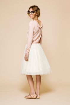 full skirt and pink cardigan, a ballerina look.