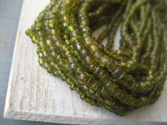 Small seed glass beads translucent oilve green  by yukidesigns, $6.00