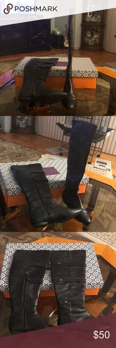 Isola black leather knee high boots Isola black leather 18.5 inch knee/above knee high boots with side zip closure and leather strap detail with studs. Flat heel.  Like new. Worn once. Isola Shoes Over the Knee Boots