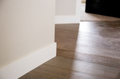 Mouldings | base comes in a wide variety of profiles from highly decorative and ten inches tall, or more, to simple S4S material that's been prefinished, like this.  in this application it meets the floor directly without a quarter-round base shoe | Bayer Built Woodworks, Inc.