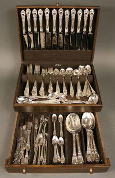 Silver flatware in mahogany case