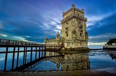 """""""Belém"""" Tower - Lisbon, Portugal - Belém Tower or the Tower of St Vincent is a fortified tower located in the civil parish of Santa Maria de Belém in the municipality of Lisbon, Portugal. It is a UNESCO World Heritage Site (along with the nearby Jerónimos Monastery) because of the significant role it played in the Portuguese maritime discoveries of the era of the Age of Discoveries.The tower was commissioned by King John II to be part of a defense system at the mouth of the Tagus river and…"""