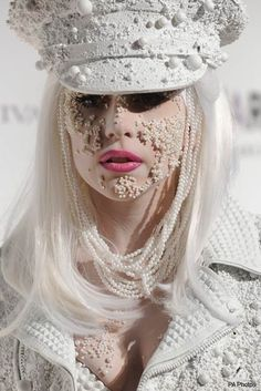 Lady Gaga and pearls. Not understated elegance.