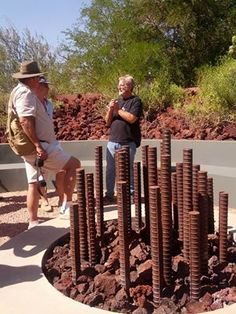 Brilliant Fire Pit - Now here's an inexpensive, DIY fire pit idea: Custom fire pit by Steve Martino. Huge rebar that lets the fire go up about 6-7' and when it's turned off the rebar still provides heat.