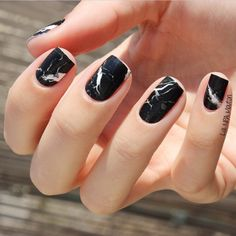 Take your matte black nails to the next level with these marbelized nail wraps from @shopncla