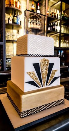 Amazing gold white and black wedding cake