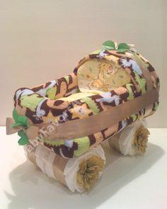 Safari Baby Carriage Diaper Cake http://babyfavorsandgifts.com/safari-baby-carriage-diaper-cake-p-99.html