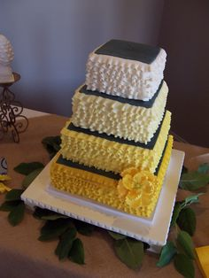 Four Tier Square Wedding Cake With Cream To Gold Ombre Ruffles Charcoal Tops And A