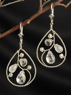 """An interwoven filigree of wire wraps itself amongst dazzling Moonstones and White Topaz briolettes and tiny white seed pearls. These opulent earrings are easy to wear and so versatile! Dress them up or down. Our Ethereal Woven Hoops hang 2"""" long as shown on leverbacks. Also available on studs or french wires. Choose from sterling silver or 22kt gold vermeil. $106 to $118"""