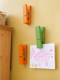 Hang kid's art on wall, clothes pins
