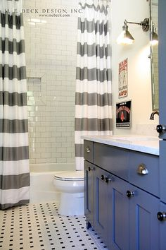 The Fat Hydrangea: Bath Similar Floor tile: 2-inch octagonal white matte with black dot, Daltile, Home Depot; wall tile: 3- by 6-inch white subway tile, Daltile, Home Depot