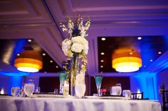 Centerpieces of white hydrangea, delphinium, ivy, and branches | Boston Marriott Long Wharf | Image by Saavedra Photography + Johnny Arguedas