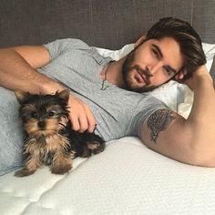 Who's cuter, the guy or the dog?