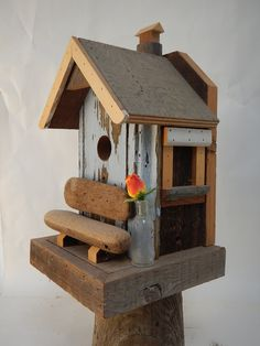 Bird house with a bench.