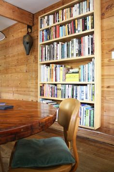 I like how this bookshelf floats off the floor. (Mark Maček's Modern, Warm & Woodsy House Tour | Apartment Therapy)