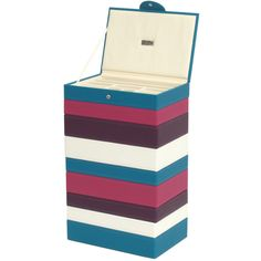 Tall multi-colored stack of stackable jewelry trays.
