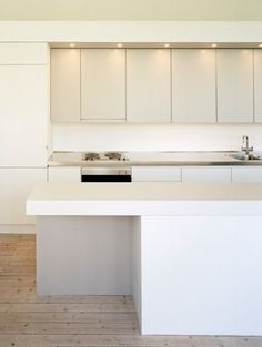 kitchens-light-wood-white-cabinets-countertops-kitchen-islands-wood-floors