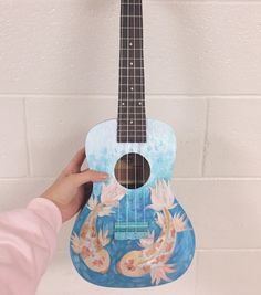 (hoodie from i am so sad bc this uke isn't actually mine so i had to return it bc i finished painting it :'( goodbye my child i love painting on unusual things, do you have any new ideas for things to paint on? Ukulele Art, Ukulele Songs, Guitar Diy, Cool Guitar, Guitar Painting, Diy Painting, Ukelele Painted, Painted Guitars, Ukulele Design
