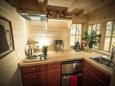 Everything you need in this picture- a stove, a sink, a fridge, a prep area, and a GREAT VIEW!  @JoeTHH www.tinyhousehacks.com