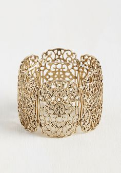 Filigree's a Crowd Bracelet. This golden bracelet is just as equipped to keep your ensemble company as it is to mingle with other accessories. #gold #wedding #modcloth