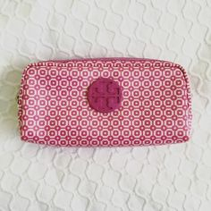 Patterned Tory Burch Makeup Bag Tory Burch cosmetic bag. Fun geometric print in pink/purple. Great condition. Purchased from another seller and never used it! Tory Burch Accessories