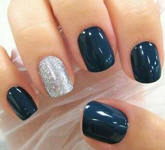 Navy nails with glitter ring finger.