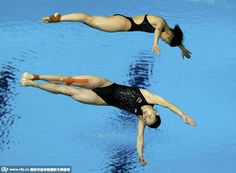 (CRI) Chinese olympic champion Wu Minxia and two-time world champion Shi Tingmao clinched their second-straight world title in the three-meter women's synchronized springboard event of FINA World Championships in Kazan, Russia on Saturday.   http://www.chinasportsbeat.com/2015/07/china-storms-diving-events-on-day-2-of.html