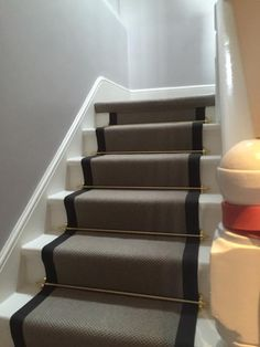 portfolio carpets grey stairs black border golden stairrods 10