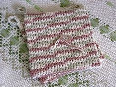 Favorite Crocheted Hot Pads ~~   As you add rows, you will see that the bottom is rounded and that you are making the hot pad double. Each row lays halfway across the previous row. This makes the hot pad nice and thick.