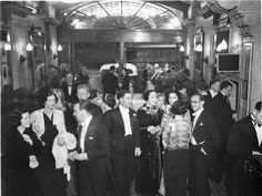 Crowd in evening dress in foyer of the Theatre Royal, Sydney, ca. 1934 / photographer Sam Hood. State Library of New South Wales via Flickr.