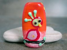 Whimsical Lampwork Glass Folk Art Stick Bird Wicked Orange with Red Divine Spark Designs SRA LeTeam. $42.00, via Etsy.
