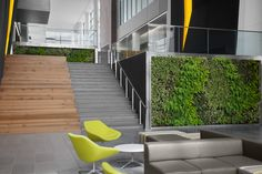 Goodyear Global Headquarters by Vocon Gensler Akron Ohio 02 Goodyear's Global Headquarters by Vocon Gensler, Akron Ohio Commercial Architecture, Architecture Office, Visual Merchandising, Vertical Green Wall, Green Office, Office Lounge, Office Space Design, Akron Ohio, Corporate Interiors