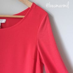 "F21 | layered curved hem Long Sleeve Top F21 | Coral Long Sleeve Top  Stunning • double layers of rayon • curved hem • cotton sleeves for subtle contrast • Spice up the colder days to come • perfect layered under blazer or open knit sweaters • feels amazing on !!   Measurements \ 24"" long 16"" bust 26"" sleeve Forever 21 Tops"